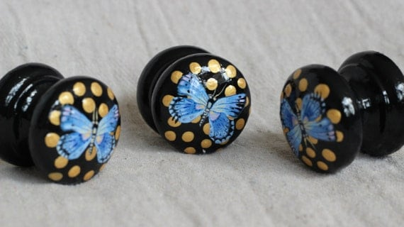 Black knob with blue butterfly and gold dots