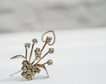 Small flower brooch, silver tone, clear rhinestones, vintage