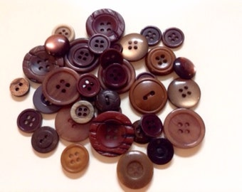 Buttons varied in Brown plastic of different sizes.