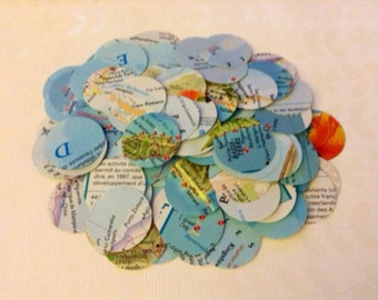 50 paper circles from a geography map