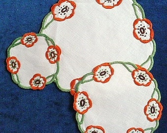 Linen mats, vintage, a set of 3 graduating, hand embroidered, floral, orange & brown c 1940's- early 50's.      n