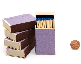 Five matchboxes, wooden matches with royal blue heads inside, striker from two sides, handpacked