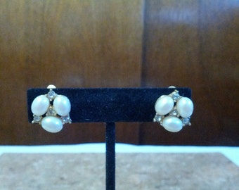 Classy Richielieu clip on earrings set with gold tone metal, faux pearls and shiny crystals