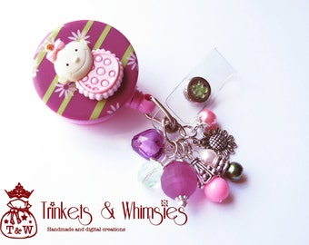 A Bundle of Mauve Baby Retractable ID Badge Holder