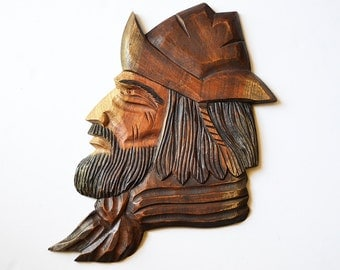 carved wooden man cabesa