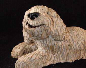 White smiling dog figurine
