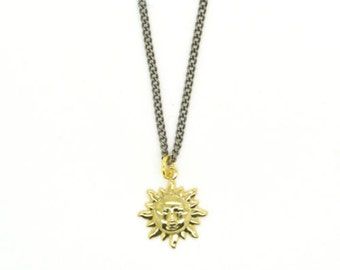 Gold Tone Sun Charm Pendant Necklace On Gun Metal Chain