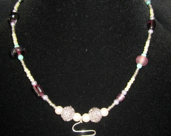 Beaded necklace with wire work pendant.