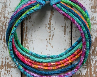 Crochet cord necklace in soft multicolor, handpainted cotton and transparant beads
