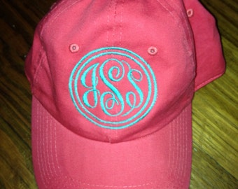 Coral hat with monogram or sorority letters and outline circle