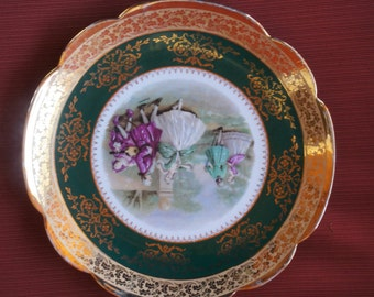 "Limoges of France. Fragonard plate. Decorative romantic dancing scene. Green with gold edging.  11.25"". Made before the 1960's"