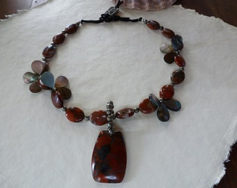 Earthy agate pendant and beads, black shells and pyrites with deep brown deerhide laced pewter toggle makes my  Red Rocks Necklace