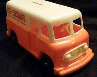 Vintage delivery van truck coin bank, in original plastic wrap.  Antique EZE Orange brand drink promo collectible. Brand new MINT condition.