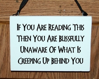If you are reading this then you are blissfully unaware of what is creeping up behind you halloween wood door hanger sign