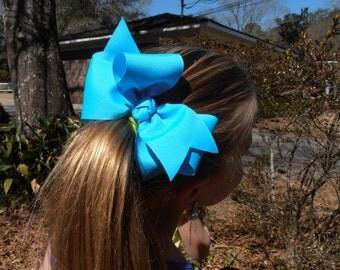Jumbo bow on a gator clip.