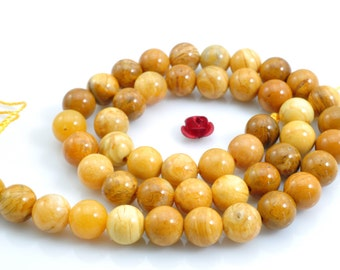 62 pcs of African Yellow Jade smooth round beads in 6mm