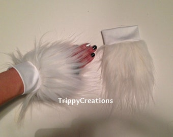 Fluffies white fluffie wrist cuffs. Great for raves, festivals, and gogo dancers.