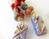 Red and blue polymer clay, lampwork, and sari ribbon earrings