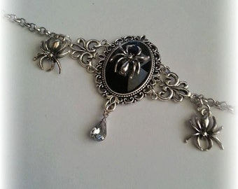 Spin bracelet with cabochon and rhinestone