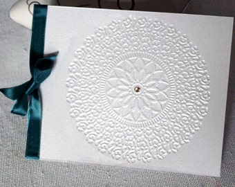 Wedding card with embossed cover