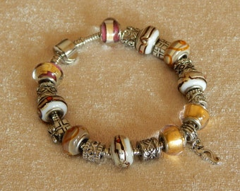 Lovely Add a Bead Bracelet in Rich Gold and Silver Tones