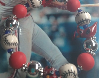 Stretch cardinal and ceramic baseball bracelet.