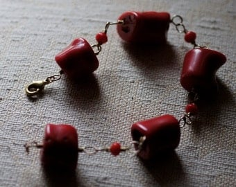 Ref: 100  Natural red bamboo coral GF bracelet.