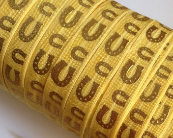 "Metallic Gold Horseshoe pattern on Yellow 5/8"" Fold Over Elastic 1, 3 or 5 yards"