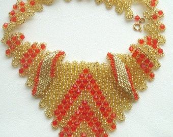 Golden bead necklace and red crystals