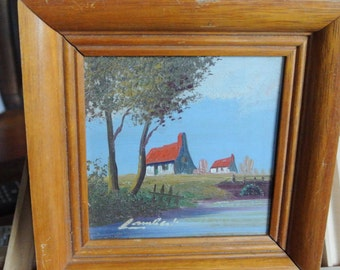 Beautiful old vintage small painting houses near a river