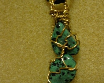 Green Dalmation stones in gold tone wire wrapping