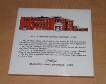 Vintage 1983 collectible souvenir trivet tile commemorating the Stanhope, Iowa Centennial in 1983, and recognizing the Stanhope School Build