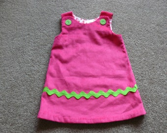Bright pink winter pinafore in size 2,