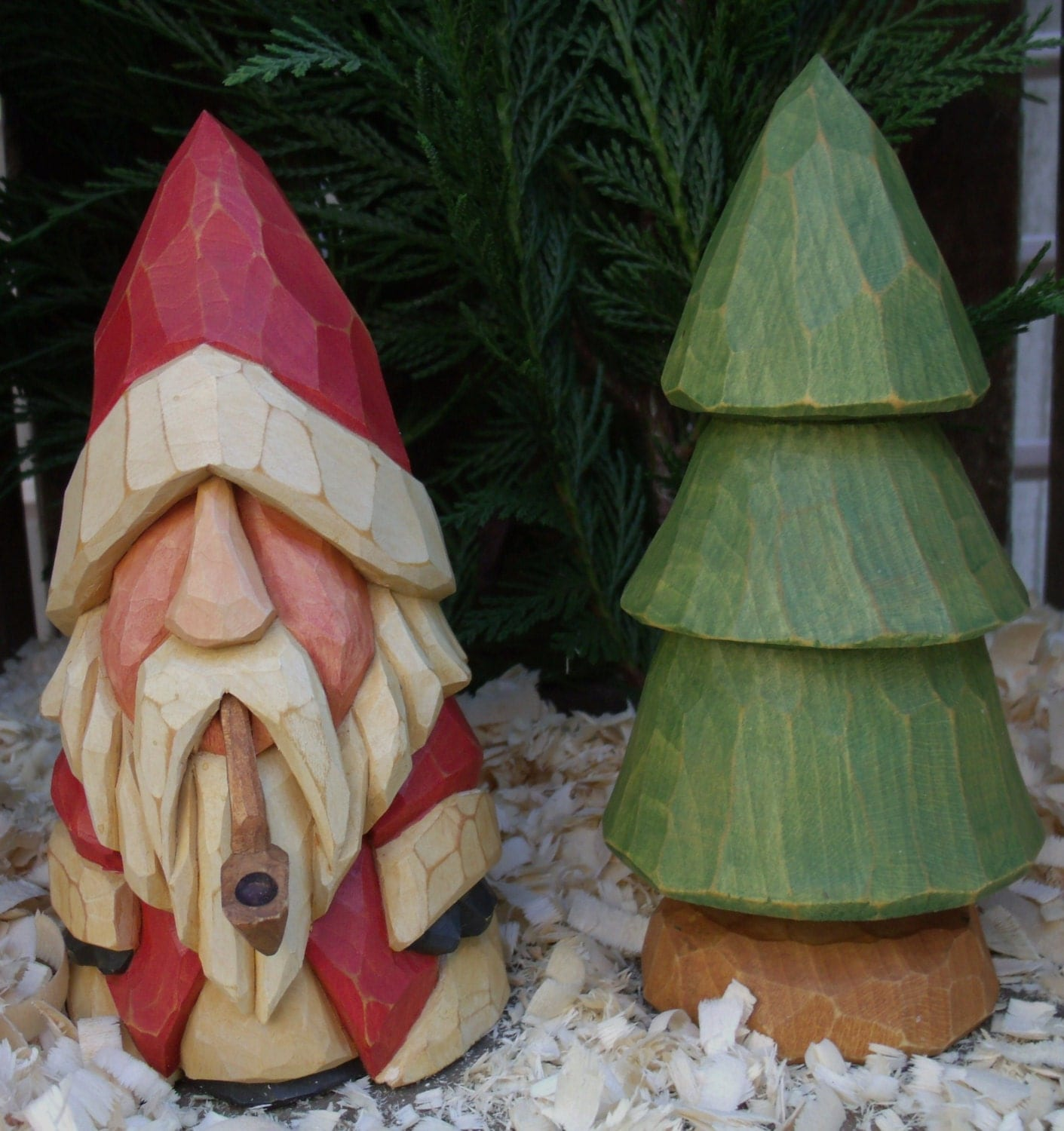 Hand carved santa with pipe and tree