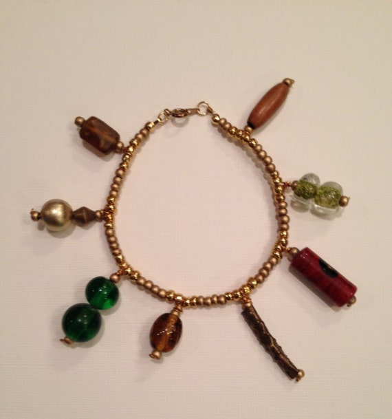 Fall colors beaded bracelet with golden, wood, metal and glass ceramic beads