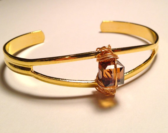 Brass bracelet with wrapped Swarovski golden square crystal