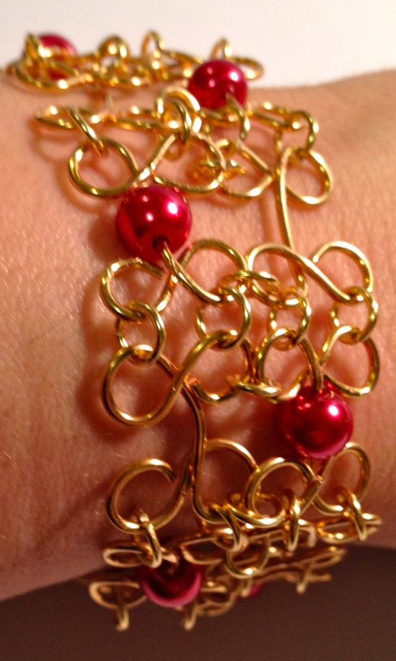 Dark red pearls with gold-plated wire work bracelet
