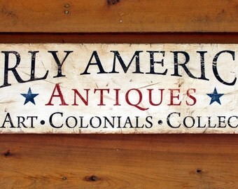 Rustic wooden sign 'Early American Antiques'