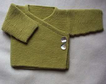 NEWBIE hand knitted merino wool baby jacket cardigan garter stitch wrap front  closed with two shell buttons and a small tie inside.