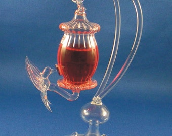 "hand blown glass hummingbird feeder with glass stand  7"" overall height"