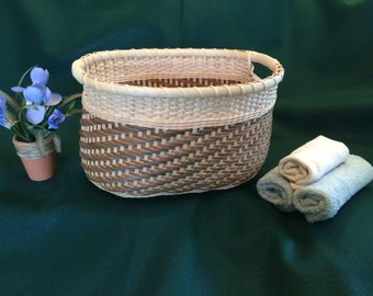 "Zeus basket woven with distinctive brown (""smoked"") reed"
