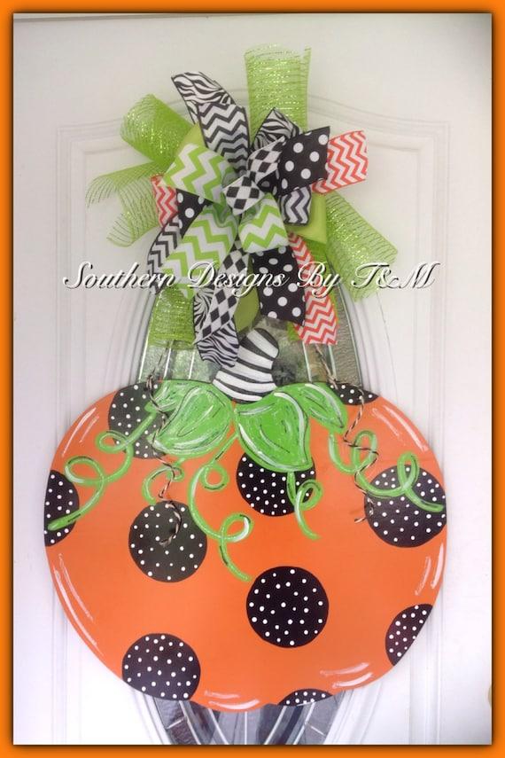 Items similar to jumbo polka dot pumpkin door hanger wall