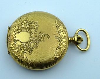 Longines 18ct gold ladies hunter pocket watch dates to 1911