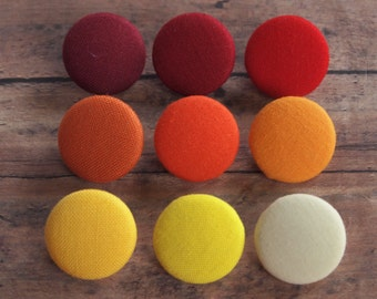 Solid colorful fabric covered buttons in Red, Orange, and Yellow (size 60, 40, 32, 20, or 18)