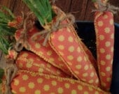 Set of four carrots made out of vintage material