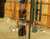 Small rain chain. Made from old insulators and nail crosses.