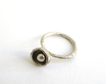 Ring with hidden ball.