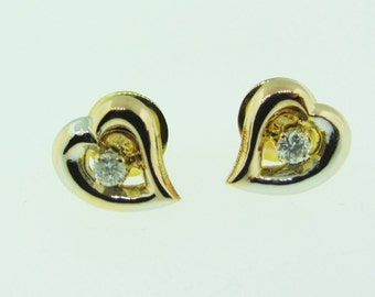 18 karat two-tone gold and diamond vintage earrings.