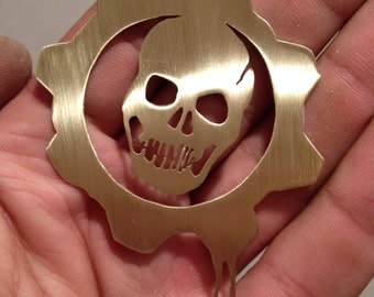 Handmade brass Gears of War symbol cutout