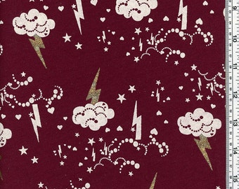 Cotton fleece fabric with clouds and glittery lightning bolts by the yard